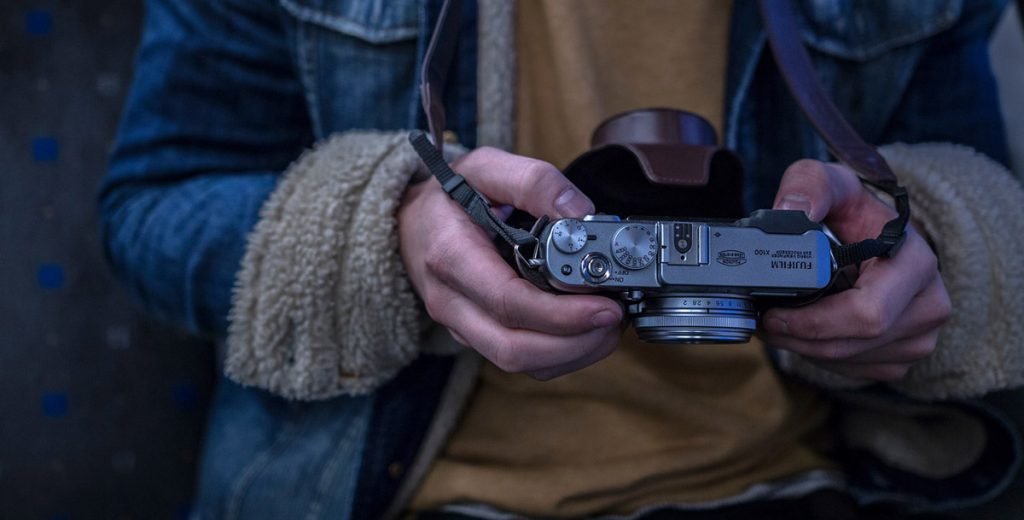 Kamera Jeansjacke Hände
