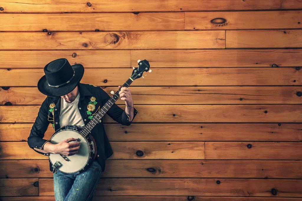 Gitarre Männermode Hut Jeanshose